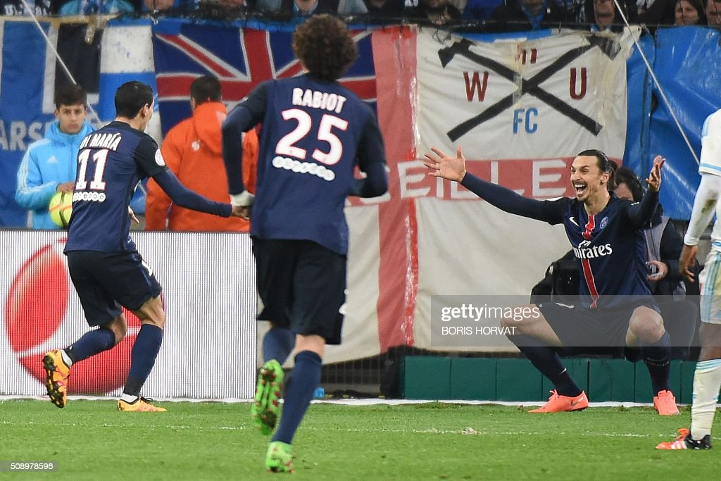 Paris-Saint-Germain's Angel Di Maria (L) celebrates with Zlatan Ibrahimovic (R) after the second goal, during their French L1 football match Olympique of Marseille (OM) versus PSG at the Velodrome stadium in Marseille on Febuary 7, 2016. AFP PHOTO / BORIS HORVAT / AFP / BORIS HORVAT