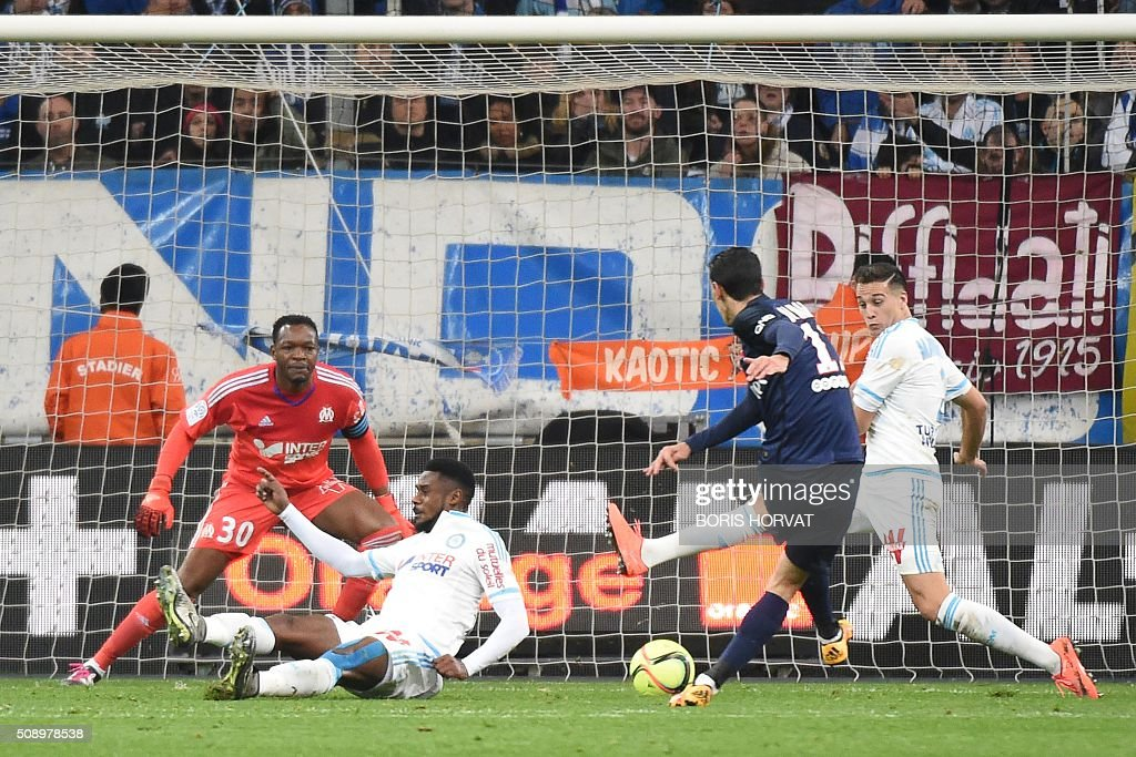 Paris-Saint-Germain's Angel Di Maria (2R) scores the second goal, during their French L1 football match Olympique of Marseille (OM) versus PSG at the Velodrome stadium in Marseille on Febuary 7, 2016. AFP PHOTO / BORIS HORVAT / AFP / BORIS HORVAT