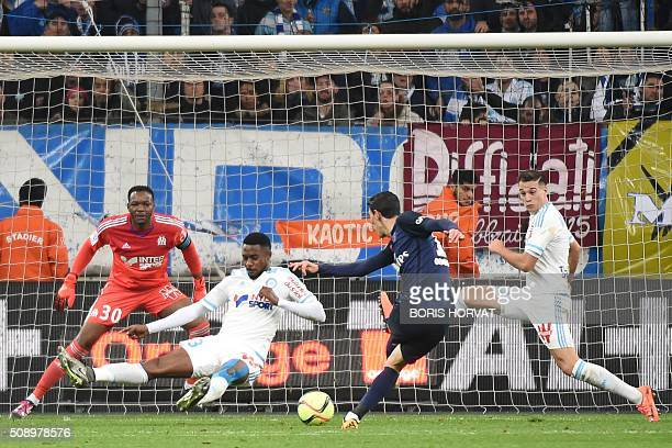 ParisSaintGermain's Angel Di Maria scores the second goal during their French L1 football match Olympique of Marseille versus PSG at the Velodrome...