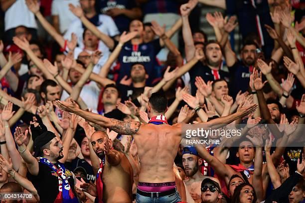 ParisSaintGermain's fans cheer prior to the UEFA Champions League Group A football match between ParisSaintGermain vs Arsenal FC on September 13 2016...