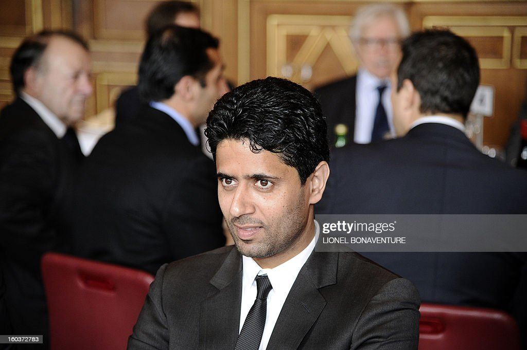 Paris-Saint-Germain's French L1 football club (PSG) chairman Nasser Al-Khelaifi (R) of Qatar, attends the annual lunch of the PSG team at the Paris city hall, on January 30, 2013.