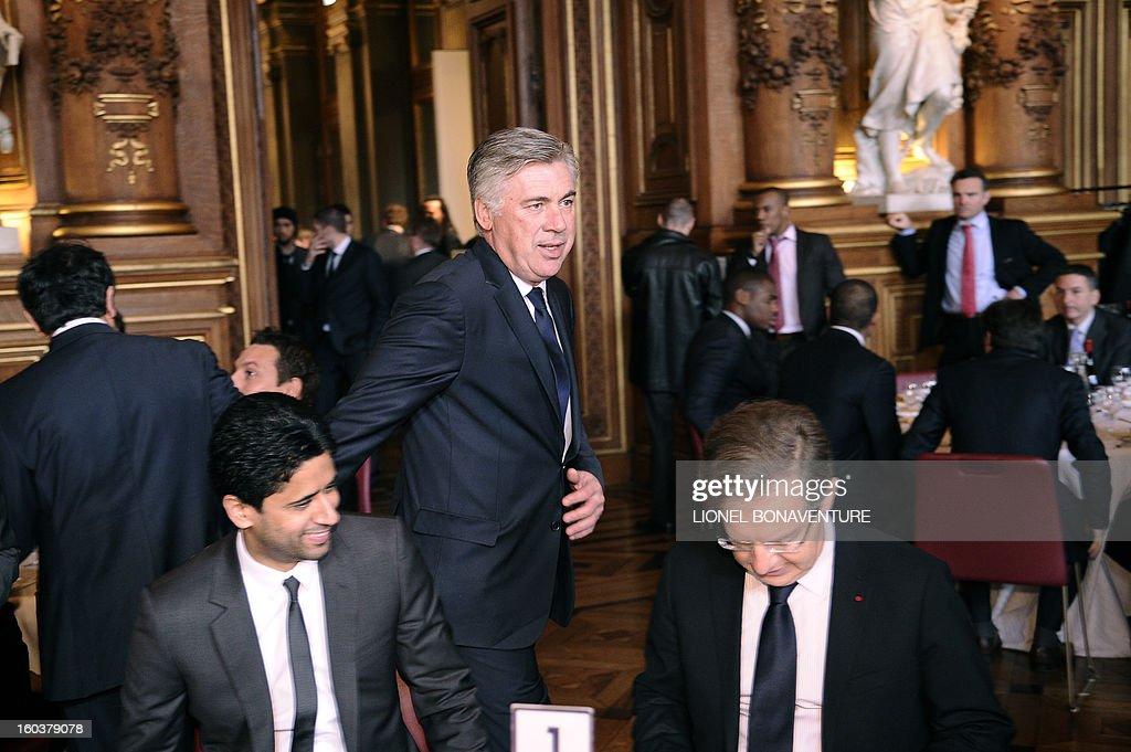 Paris-Saint-Germain's French L1 football club (PSG) chairman Nasser Al-Khelaifi (L) of Qatar, and Paris Saint-Germain's head coach Carlo Ancelotti (C) attend the annual lunch of the PSG team at the Paris city hall, on January 30, 2013.