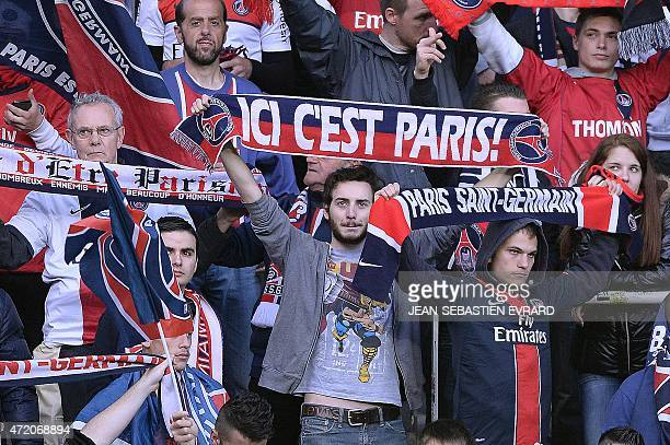 ParisSaintGermain's supporters wave scarves before the French L1 football match between Nantes and ParisSaintGermain on May 3 2015 at the Beaujoire...