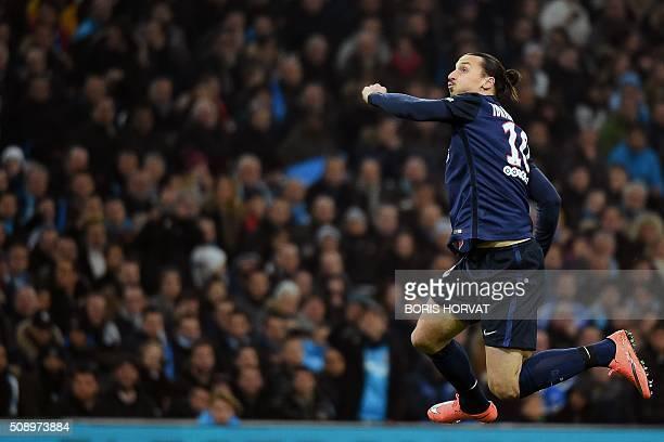TOPSHOT ParisSaintGermain's Swedish forward Zlatan Ibrahimovic celebrates after scoring a goal during the French L1 football match between Marseille...