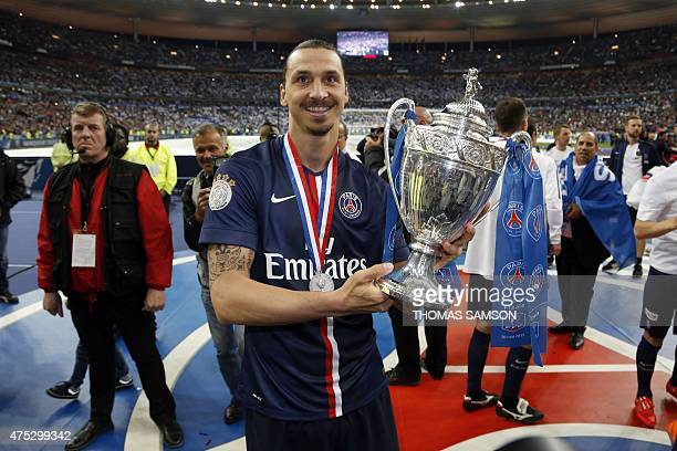 ParisSaintGermains Swedish forward Zlatan Ibrahimovic holds up the trophy after winning the French Cup final football match against Auxerre at the...