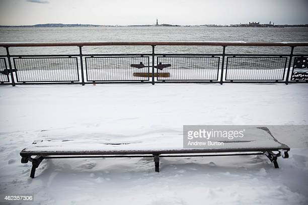 A park bench is covered in snow after a snowstorm on January 27 2015 in New York City The storm which was predicted to dump 2030 inches of snow...