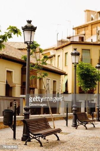 Park benches near lampposts, Toledo, Spain : Stock Photo