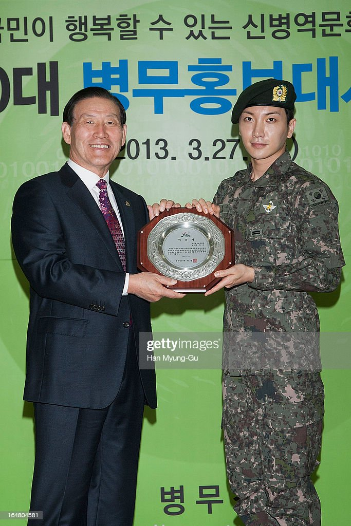 Park Chang-Myung, Commissioner of The Military Manpower Administration and <a gi-track='captionPersonalityLinkClicked' href=/galleries/search?phrase=Leeteuk&family=editorial&specificpeople=8659856 ng-click='$event.stopPropagation()'>Leeteuk</a> of South Korean boy band Super Junior pose for media during Appointed As Honorary Ambassador For Military Manpower Administration on March 27, 2013 in Seoul, South Korea.