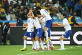 Park ChuYoung of South Korea celebrates with team mates after he scores from a free kick during the 2010 FIFA World Cup South Africa Group B match...