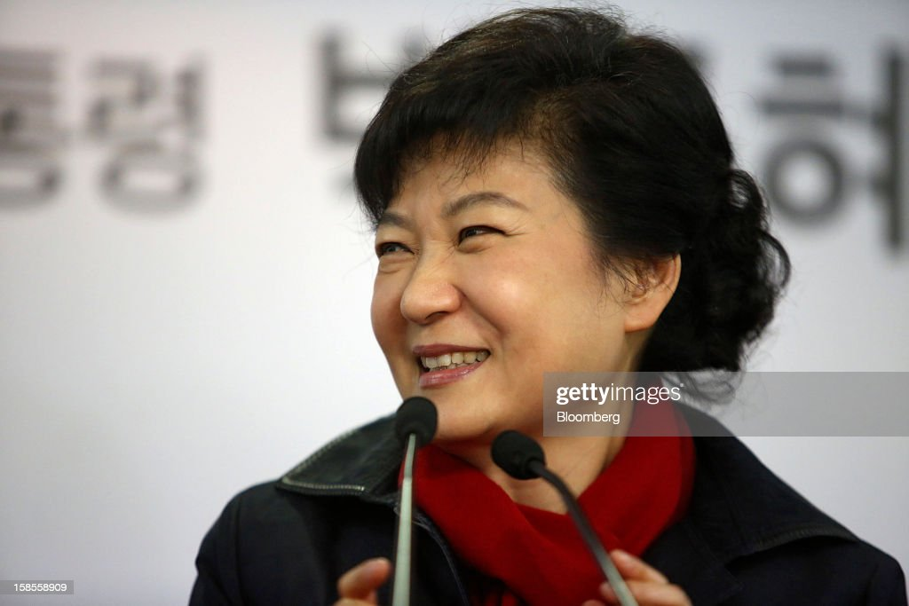 Park Geun Hye, presidential candidate from the ruling New Frontier Party, smiles while speaking at the party's headquarters in Seoul, South Korea, on Wednesday, Dec. 19, 2012. Park won the South Korean presidential election after rival Moon Jae In, the main opposition candidate, conceded defeat, according to remarks broadcast on MBN cable television. Photographer: Jean Chung/Bloomberg via Getty Images