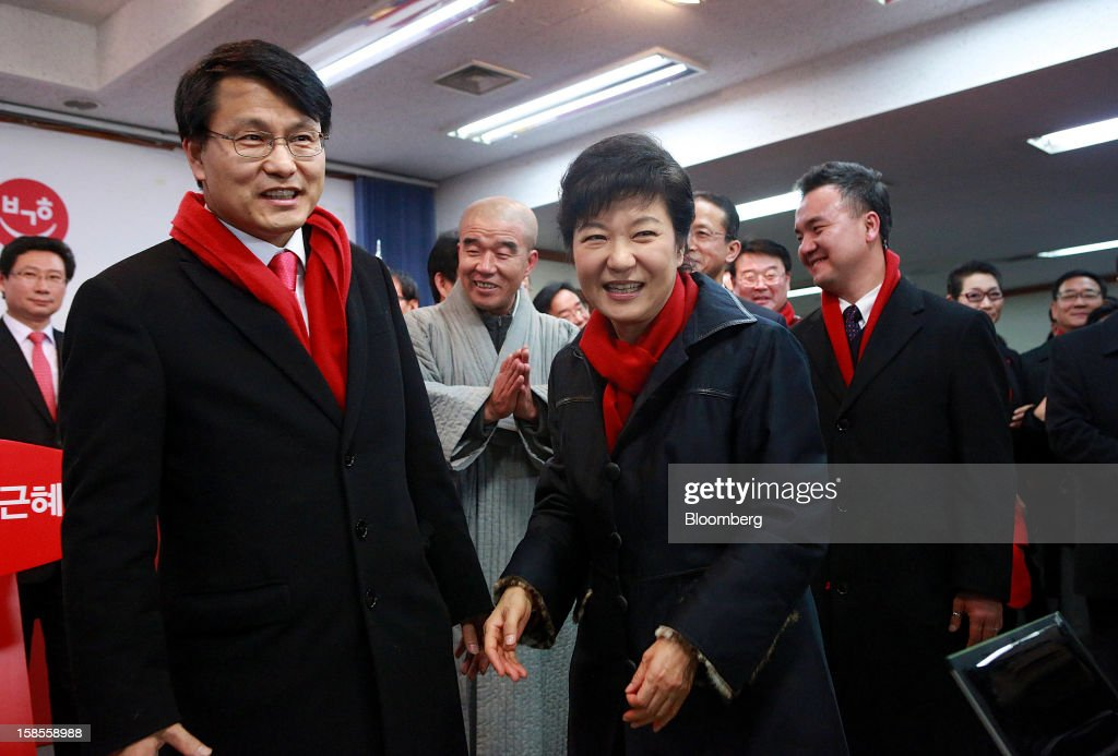 Park Geun Hye, presidential candidate from the ruling New Frontier Party, center, enters the press room at the party's headquarters in Seoul, South Korea, on Wednesday, Dec. 19, 2012. Park won the South Korean presidential election after rival Moon Jae In, the main opposition candidate, conceded defeat, according to remarks broadcast on MBN cable television. Photographer: Jean Chung/Bloomberg via Getty Images