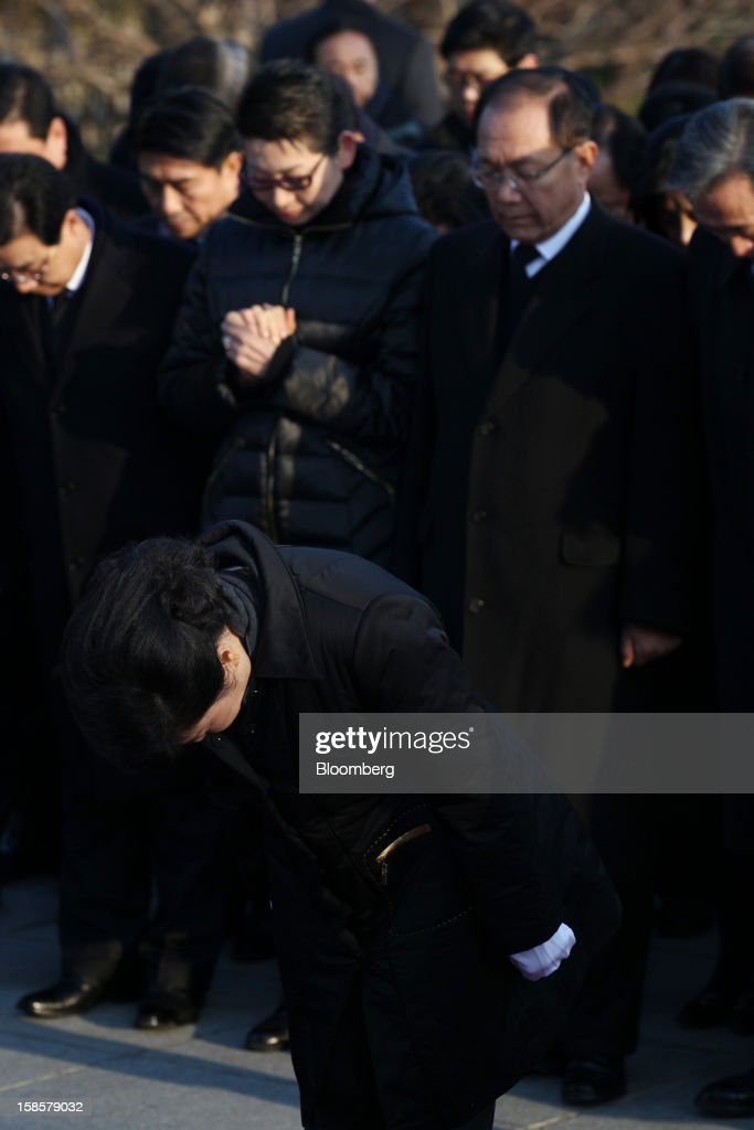 Park Geun Hye, South Korea's president-elect, bows as she observes a minute of silence on her visit to the National Cemetery in Seoul, South Korea, on Thursday, Dec. 20, 2012. Park, 60, of the ruling New Frontier Party, defeated main opposition nominee Moon Jae In, 51.6 percent to 48 percent, the biggest margin of victory in 25 years. Photographer: SeongJoon Cho/Bloomberg via Getty Images