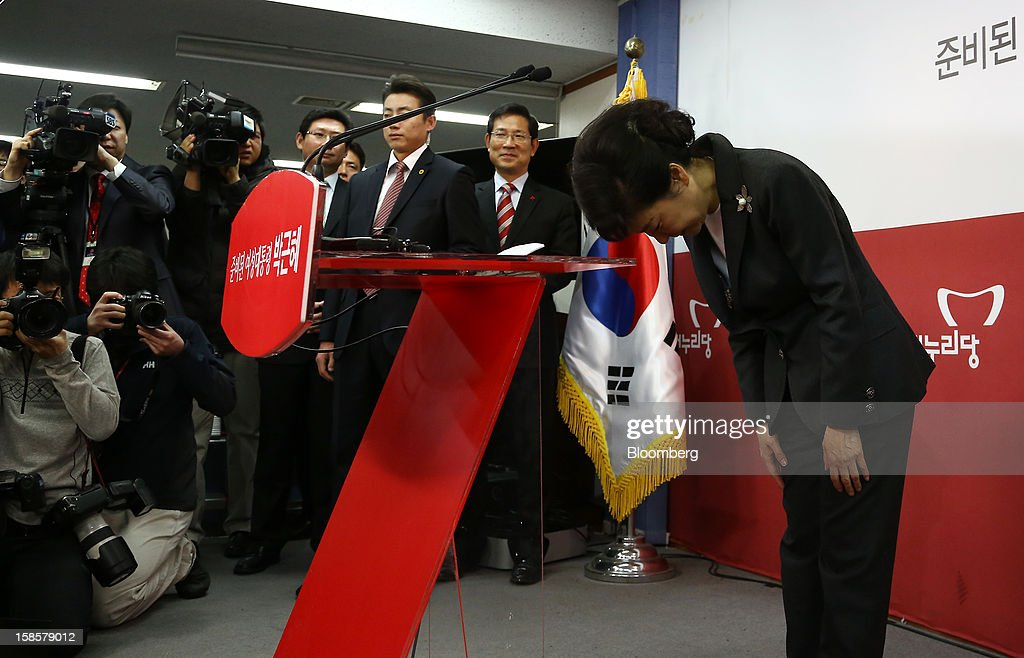 Park Geun Hye, South Korea's president-elect, bows during a news conference at the New Frontier Party headquarters in Seoul, South Korea, on Thursday, Dec. 20, 2012. Park, 60, defeated main opposition nominee Moon Jae In, 51.6 percent to 48 percent, the biggest margin of victory in 25 years. Photographer: SeongJoon Cho/Bloomberg via Getty Images