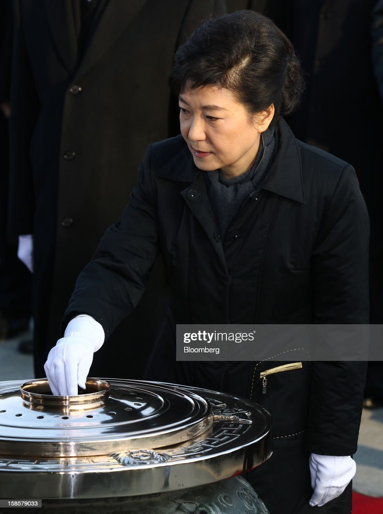 Park Geun Hye, South Korea's president-elect, burns incense on her visit to the National Cemetery in Seoul, South Korea, on Thursday, Dec. 20, 2012. Park, 60, of the ruling New Frontier Party, defeated main opposition nominee Moon Jae In, 51.6 percent to 48 percent, the biggest margin of victory in 25 years. Photographer: SeongJoon Cho/Bloomberg via Getty Images