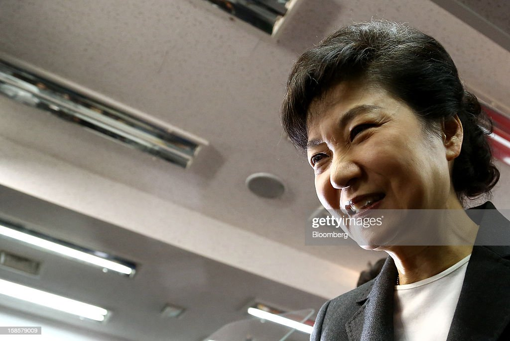 Park Geun Hye, South Korea's president-elect, leaves a news conference at the New Frontier Party headquarters in Seoul, South Korea, on Thursday, Dec. 20, 2012. Park, 60, defeated main opposition nominee Moon Jae In, 51.6 percent to 48 percent, the biggest margin of victory in 25 years. Photographer: SeongJoon Cho/Bloomberg via Getty Images
