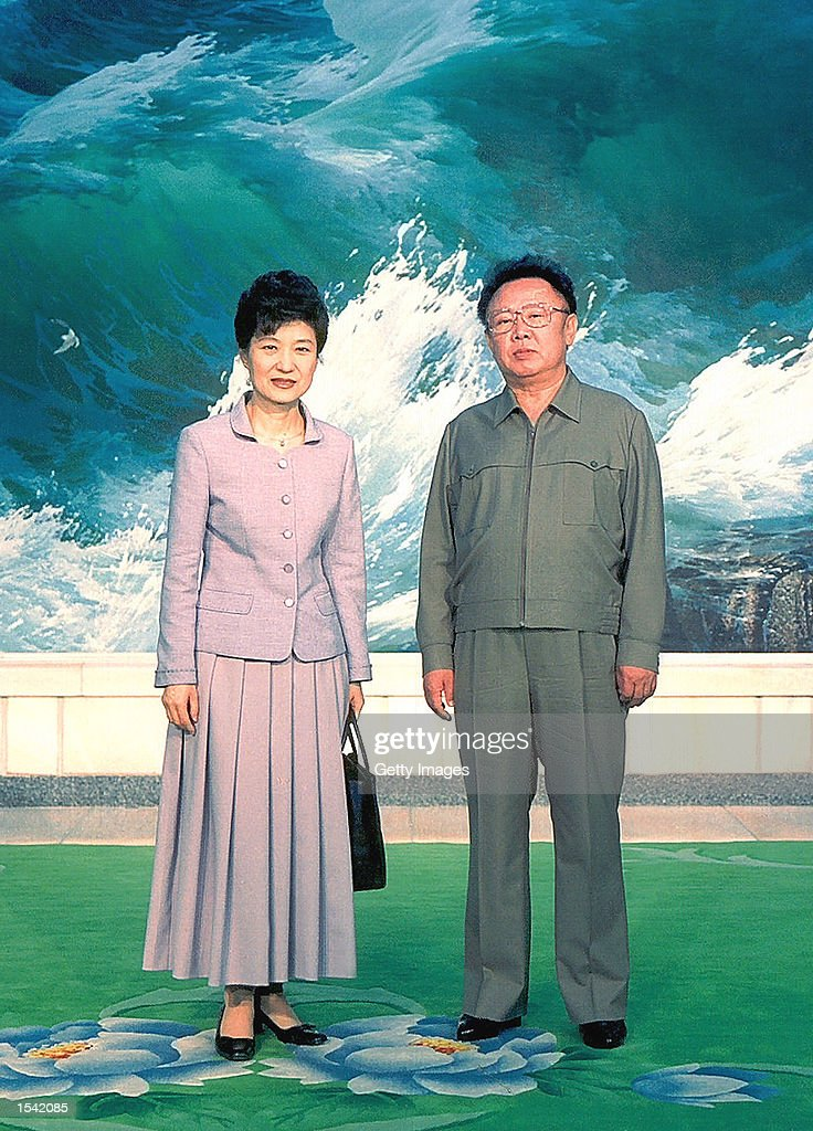Park Geunhye daughter of South Korea's former military ruler Park Chunghee poses with North Korean leader Kim JongIl May 13 2002 in Pyongyang North...
