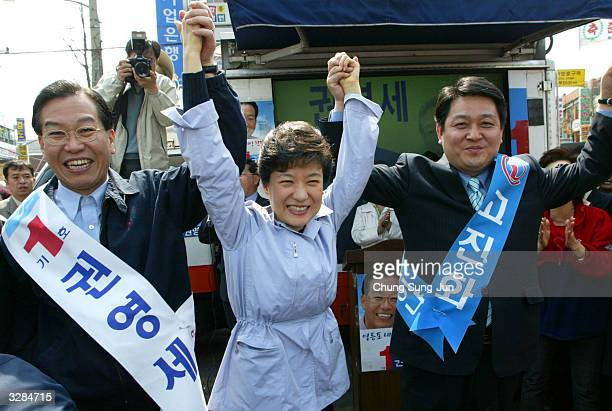 Park GeunHye the main opposition Grand National Party leader and daughter of assassinated former president Park ChungHee raises her hands with her...