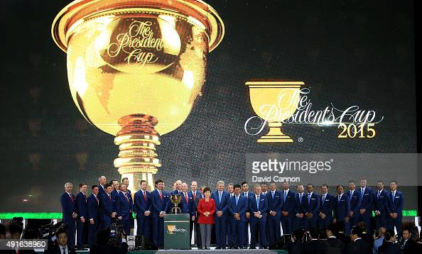 Park Geunhye The President of South Korea poses with the two teams on stage during the opening ceremony of the 2015 Presidents Cup at the Convensia...