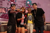 '106 Park' hosts Bow Wow Paigion and Ms Mykie pose for a picture with recording artist Chris Brown during a taping of BET's '106 Park' at BET Studios...