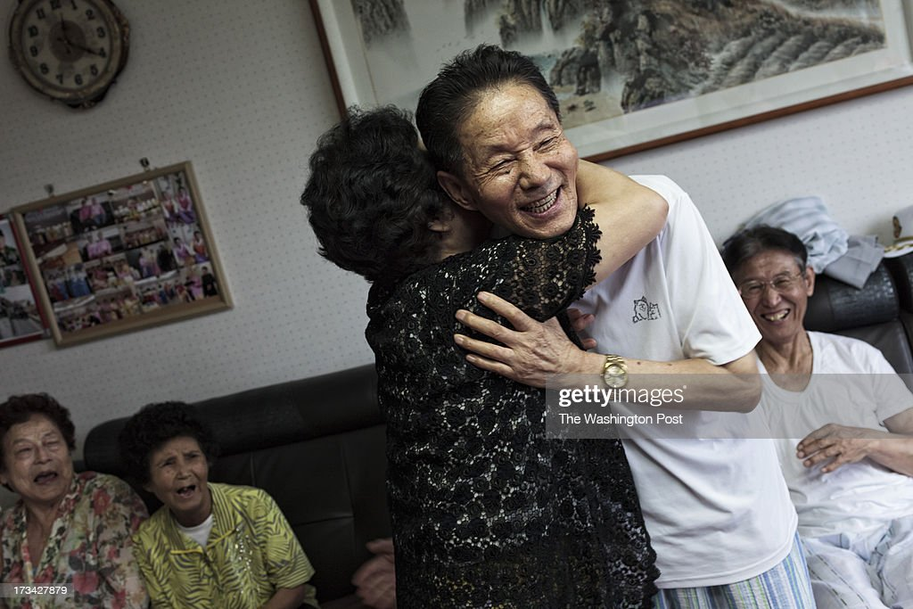 Park Hyang-sook, 75, embraces Lee Gyu-il, 81, at a care house on July 10, 2013 in Seoul, South Korea. Park escaped from North Korea with her late husband's remains in 2006. Park's late husband was POW. From left, Kim Wun-rae, 86, a wife of Lee Won-sam who escaped from North Korea in 2004, Han Geum-sook, 74, a wife of Lee Gyu-il, and Han Byung-soo, 82.
