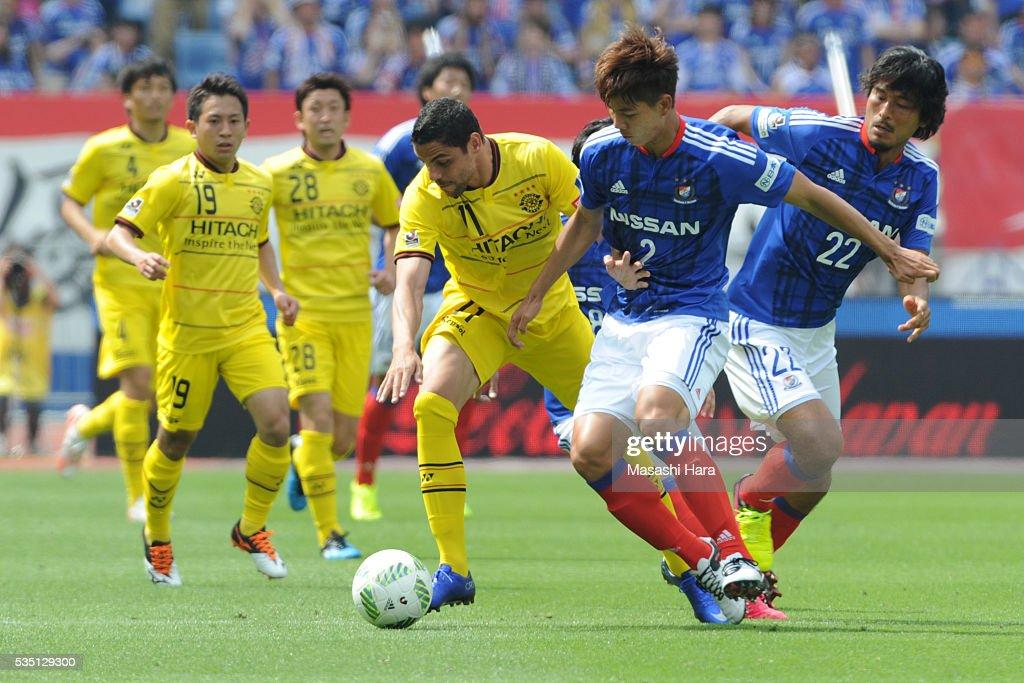 Park Jeongsu #2 of Yokohama F.Marinos and Diego Oliveira #11 of Kashiwa Reysol compete for the ball during the J.League match between Yokohama F.Marinos and Kashiwa Reysol at the Nissan Stadium on May 29, 2016 in Yokohama, Kanagawa, Japan.