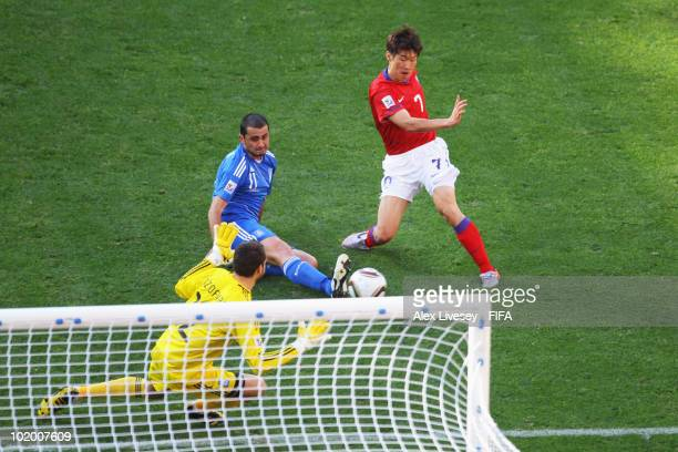 Park JiSung of South Korea scores the second goal while goalkeeper Alexandros Tzorvas and Loukas Vintra of Greece can only watch on during the 2010...