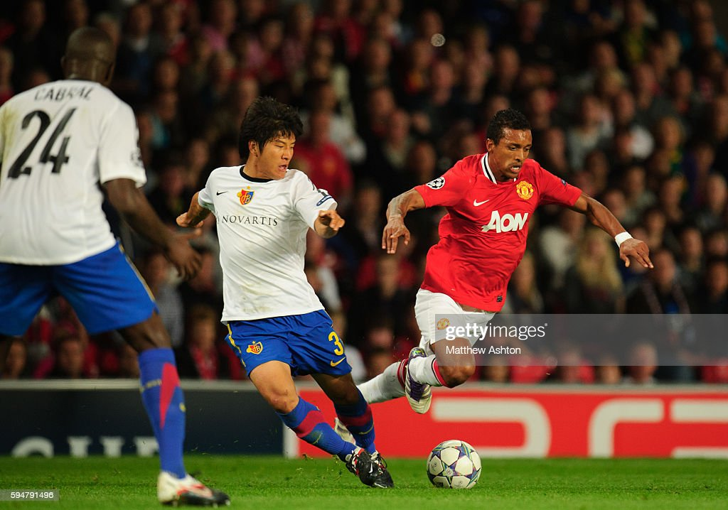 Park JooHo of FC Basel and Nani of Manchester United