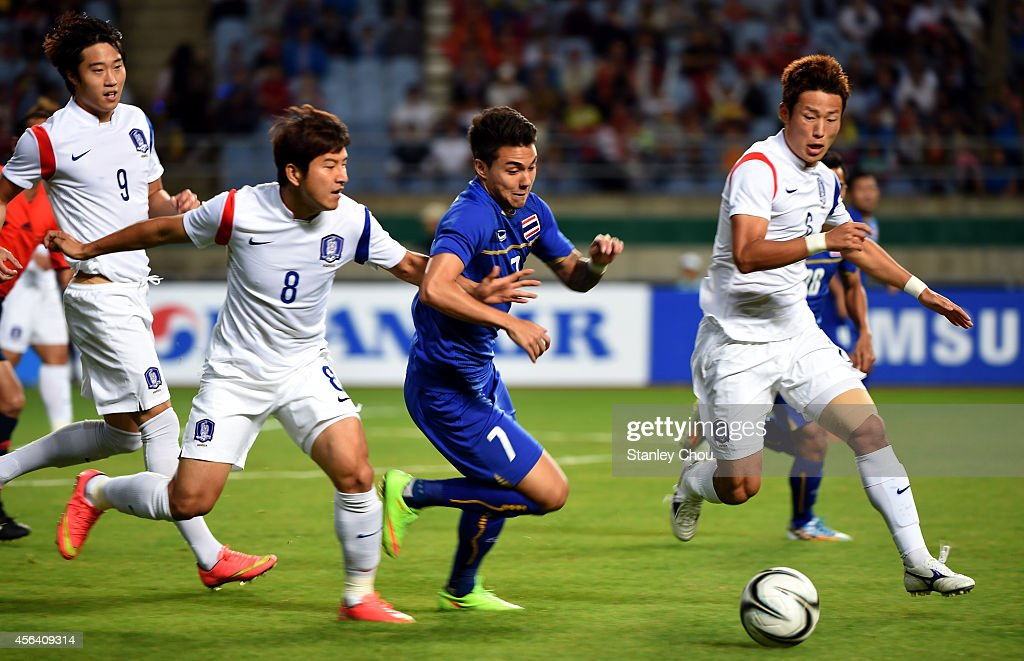 Park Jooho of South Korea Charyl Yannic Chappuis of Thailand and Son Junho of South Korea tussles for the ball during the Football Mens semifinal...