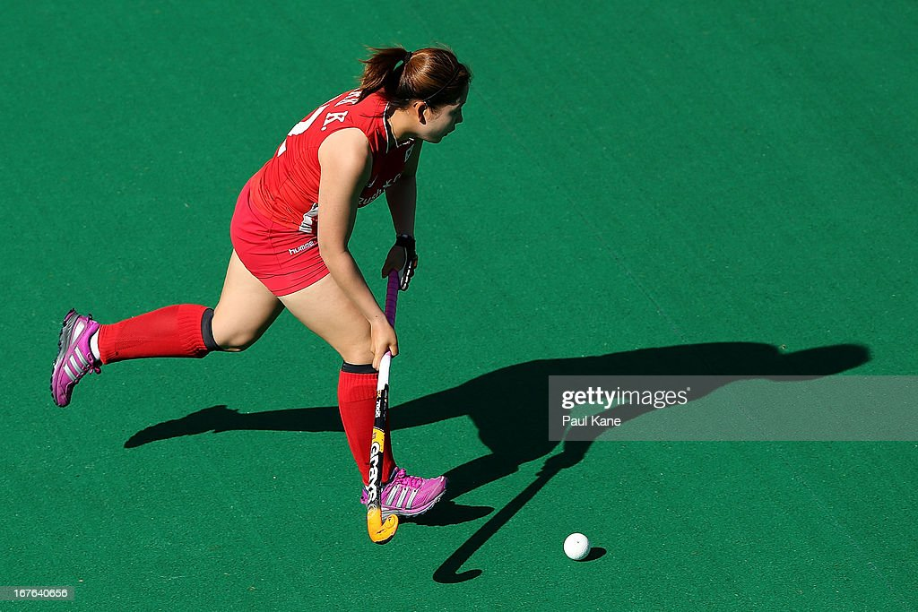 Park Ki Ju of Korea works the ball up the field during the International Test match between the Australian Hockeyroos and Korea at Perth Hockey Stadium on April 27, 2013 in Perth, Australia.