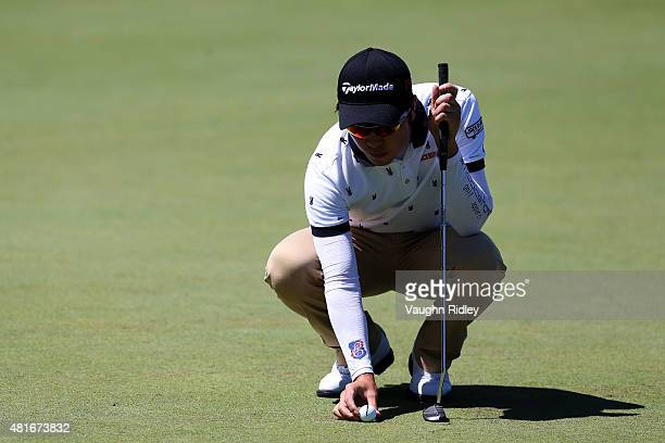 J Park lines up a putt on the third green during round one of the RBC Canadian Open on July 23 2015 at Glen Abbey Golf Club in Oakville Canada