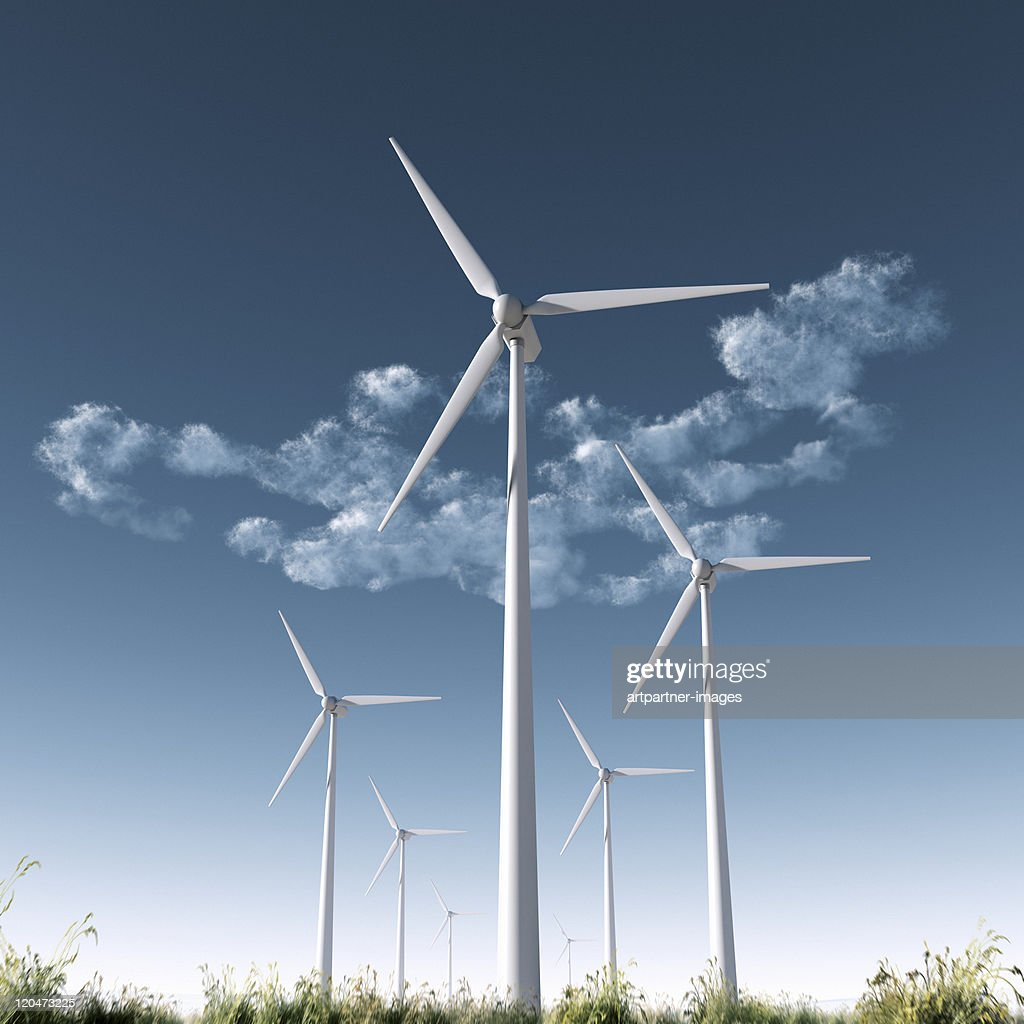 Park of Wind Turbines in front of a dark blue sky : Stock Photo