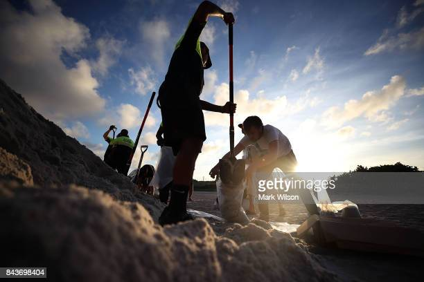 Park officials fill sand bags for residents who are preparing for approaching Hurricane Irma on September 7 2016 in Miami Beach Florida Current...