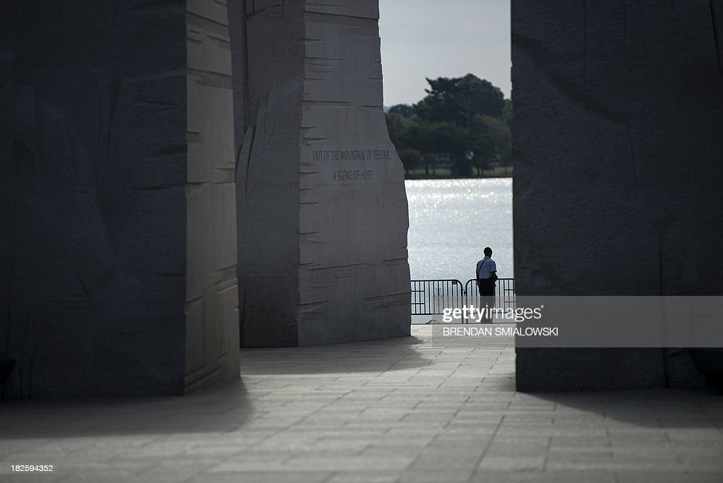 Park Police Officer stands at a closed Martin Luther King Jr. Memorial on the National Mall October 1, 2013 in Washington, DC. The US government is in a forced shutdown after lawmakers failed to pass a spending bill last night. AFP PHOTO/Brendan SMIALOWSKI