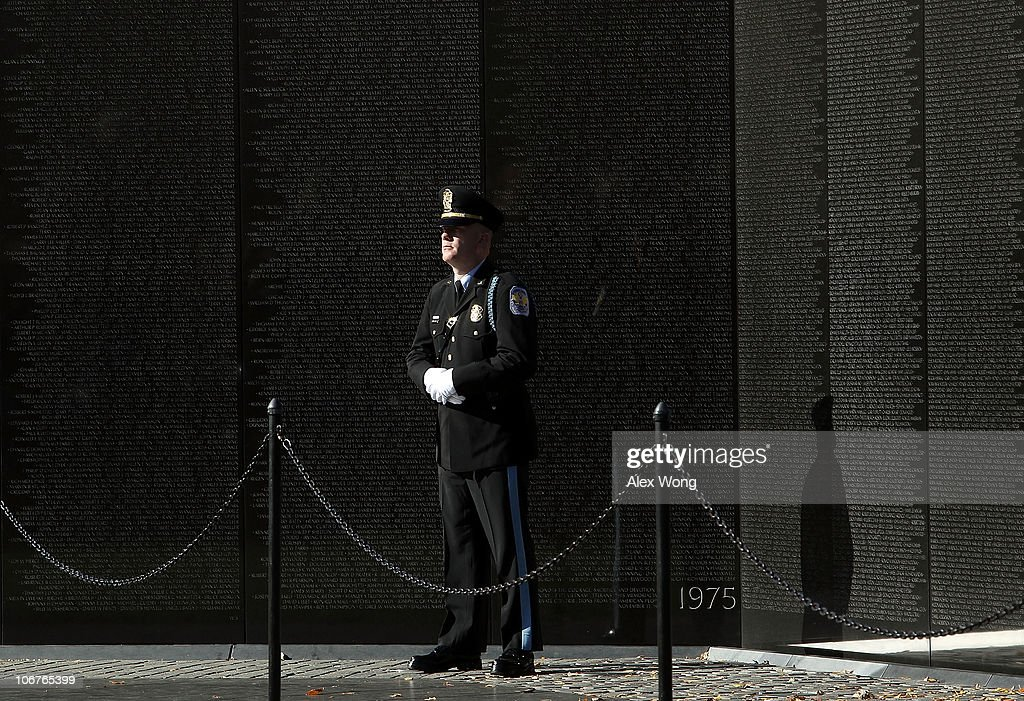 S. Park Police officer stands in front of the walls during a Veterans Day event at the Vietnam Veterans Memorial November 11, 2010 in Washington, DC. The nation's veterans were honored and remembered during the annual Veterans Day.