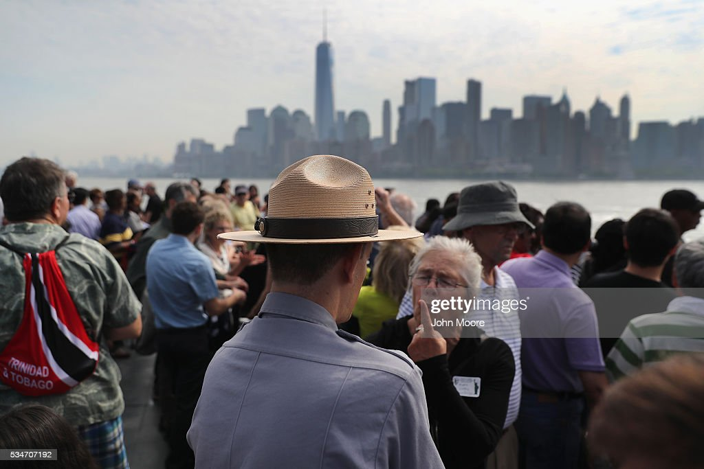S. park ranger answers questions while in route to Ellis Island on May 27, 2016 in New York City. U.S. Secretary of Homeland Security Jeh Johnson visited the historic island to administer the oath of citizenship to immigrants from 39 countries. The ceremony, held by U.S. Citizenship and Immigration Services (USCIS), was held in honor of Memorial Day and is one of 100 naturalization ceremonies held in U.S. national parks in celebration of the National Park Service's 100th anniversary.