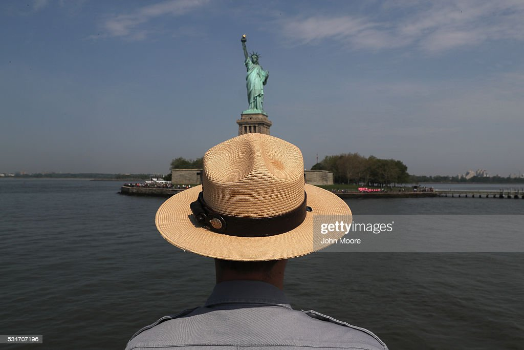 S. park ranger looks towards the Statue of Liberty while in route to Ellis Island on May 27, 2016 in New York City. U.S. Secretary of Homeland Security Jeh Johnson visited the historic island to administer the oath of citizenship to immigrants from 39 countries. The ceremony, held by U.S. Citizenship and Immigration Services (USCIS), was held in honor of Memorial Day and is one of 100 naturalization ceremonies held in U.S. national parks in celebration of the National Park Service's 100th anniversary.