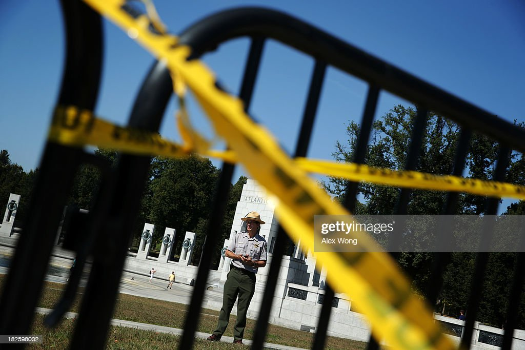 A park ranger of the U.S. National Park Service stands behind the barricades at the World War II Memorial during a government shutdown October 1, 2013 in Washington, DC. The memorial was temporary opened to veteran groups arrived on Honor Flights on a day trip to visit the nation's capital.