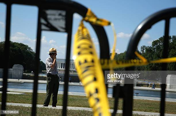A park ranger of the US National Park Service stands behind the barricades at the World War II Memorial during a government shutdown October 1 2013...