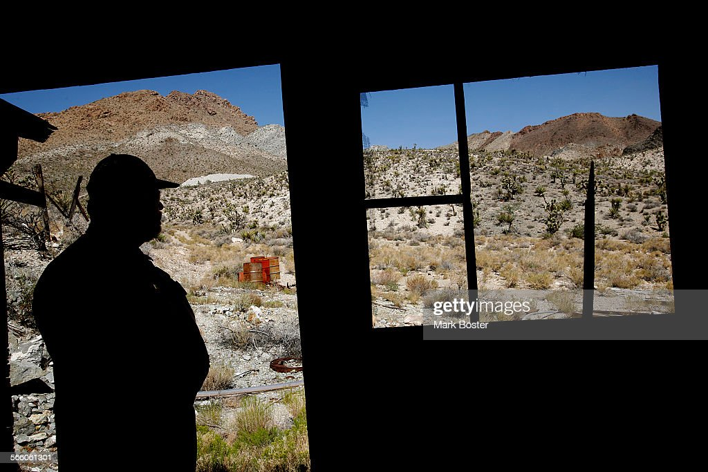 Park Ranger Tim Duncan checks the old shacks at the abandoned New Trail Mine in the Ivanpah Mountain area of the Mojave National Preserve September 4, 2008. Duncan and other rangers discovered a meth lab at the mine in 2001, leading to the arrest of two people.