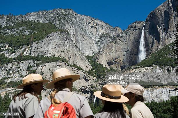 Park rangers meet in front of Yosemite Falls before President Barack Obama's speech on June 18 2016 in Yosemite National Park California Obama is...