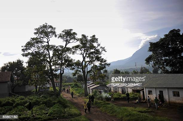 Park rangers working in the Virunga National Park and some of their family members walk on a road near their homes on November 28 2008 in Rumangabo...
