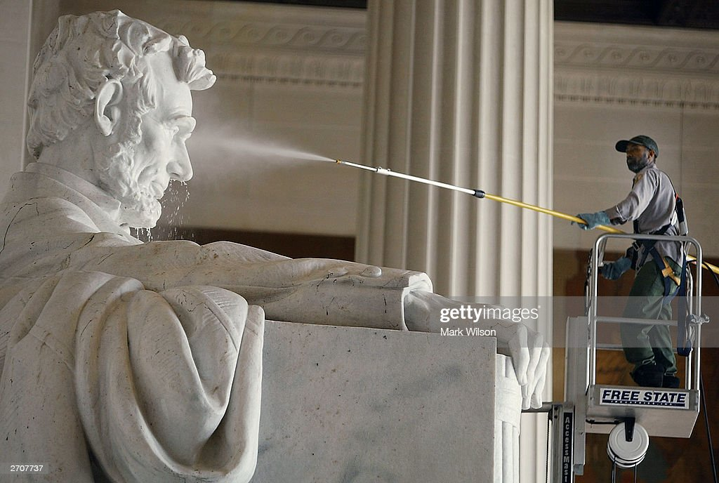 Park Service employee David Campbell cleans the statue of Abraham Lincoln at the Lincoln Memorial November 3, 2003 in Washington, DC. Twice a year the National Park Service uses a pressure washer to clean the statue.