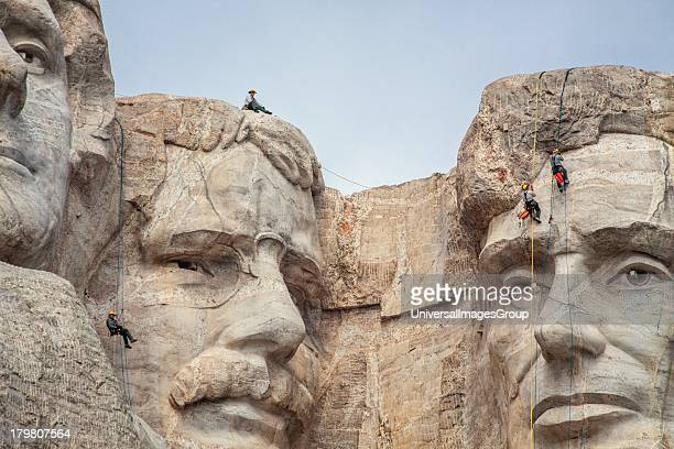 Park service employees rappel down the face of Mount Rushmore while conducting an inspection Mount Rushmore National Monument South Dakota