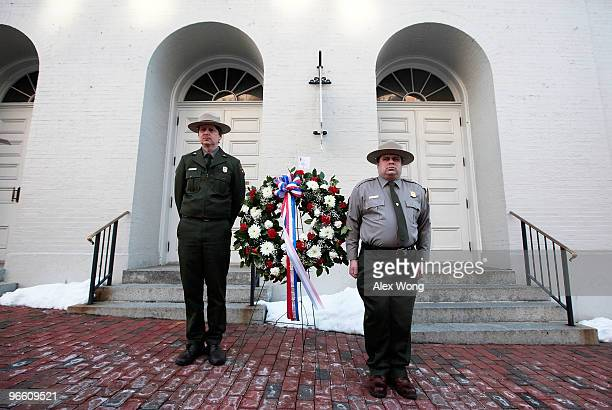 S Park Service ranger Eric Martin and park guide Jesse Wilinski stand next to a wreath after they laid it at the front steps of Ford�s Theatre to...