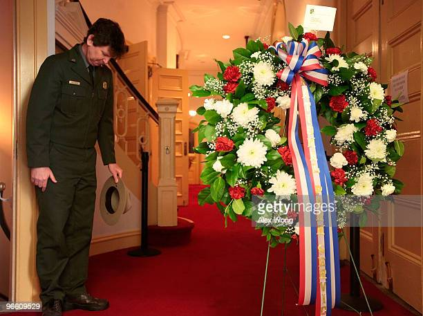 S Park Service ranger Eric Martin prepares to lay a wreath at the front steps of Ford�s Theatre to mark the 201st birthday of US President Abraham...