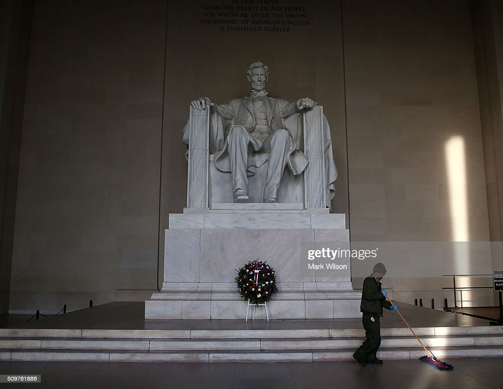 Park Service worker Ronald Price sweeps the floor of the Lincoln Memorial, February 12, 2016 in Washington, DC. The Military District of Washington held a Presidential full honor wreath laying ceremony to commemorate Abraham Lincoln's 207th birthday.