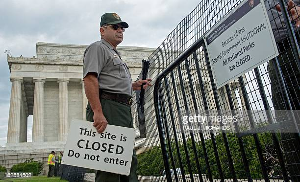 US Park Service workers fence off the closed Lincoln Monument in Washington DC October 1 as the first US Federal government shutdown since 1995...