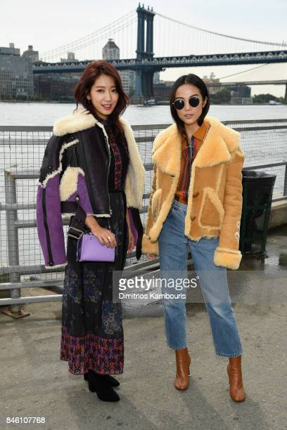 Park Shinhye and Yoyo Cao attend Coach Spring 2018 fashion show during New York Fashion Week at Basketball City Pier 36 South Street on September 12...