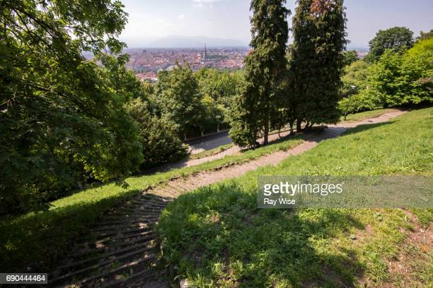 Park steps on a hill looking over city of Turin in Italy.