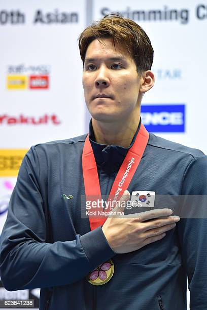 Park Taehwan of Sauth Korea stand for the national anthem on the podium after the Men's 200m Freestyle final during the 10th Asian Swimming...